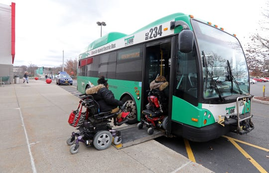 Zasia Davis, 22, left, and her sister Diana Bouknight, 28, board the bus after working at the Target in Spring Valley Nov. 27, 2018. Both use wheelchairs and the bus is their only means of transportation. On a recent night Bouknight left her shift early to catch the last bus home two miles away. The bus never showed and she was stranded for hours in the rain before another bus driver helped her home.