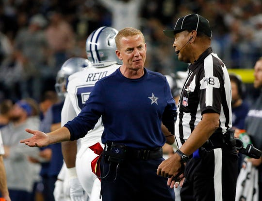 Dallas Cowboys head coach Jason Garrett, left, questions a call in the first half of an NFL football game, in Arlington, Texas, Thursday, Nov. 29, 2018. (AP Photo/Roger Steinman)