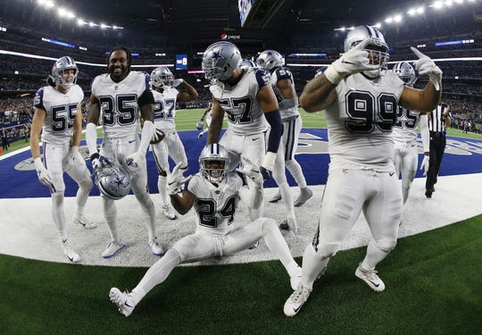 Dallas Cowboys players celebrate their win over -New Orleans Saints in an NFL football game, in Arlington, Texas, Thursday, Nov. 29, 2018. Dallas won 13-10 to improve to 7-5.