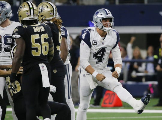 Dallas Cowboys quarterback Dak Prescott (4) celebrates after a run play against the New Orleans Saints during the second half of an NFL football game, in Arlington, Texas, Thursday, Nov. 29, 2018. Dallas won 13-10. Prescott had a rating over 100 for the third time in a four-game win streak at 115.5. He was 24 of 28 for 248 yards and also rushed for 22 yards.