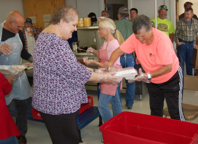The thirty-second annual free Thanksgiving Holiday Spirit Meal in Vernon was a huge success with close to 900 meals served. Volunteers are shown packing lunch plates into large containers to be delivered to shut ins.