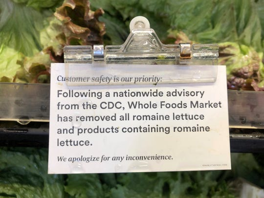A sign is posted about romaine lettuce at a Whole Foods Market in Jenkintown, Pa, Wednesday, Nov. 28, 2018. After repeated food poisoning outbreaks linked to romaine lettuce, the produce industry is confronting the failure of its own safety measures in preventing contaminations. The latest outbreak underscores the challenge of eliminating risk for vegetables grown in open fields and eaten raw. It also highlights the role of nearby cattle operations and the delay of stricter federal food safety regulations.