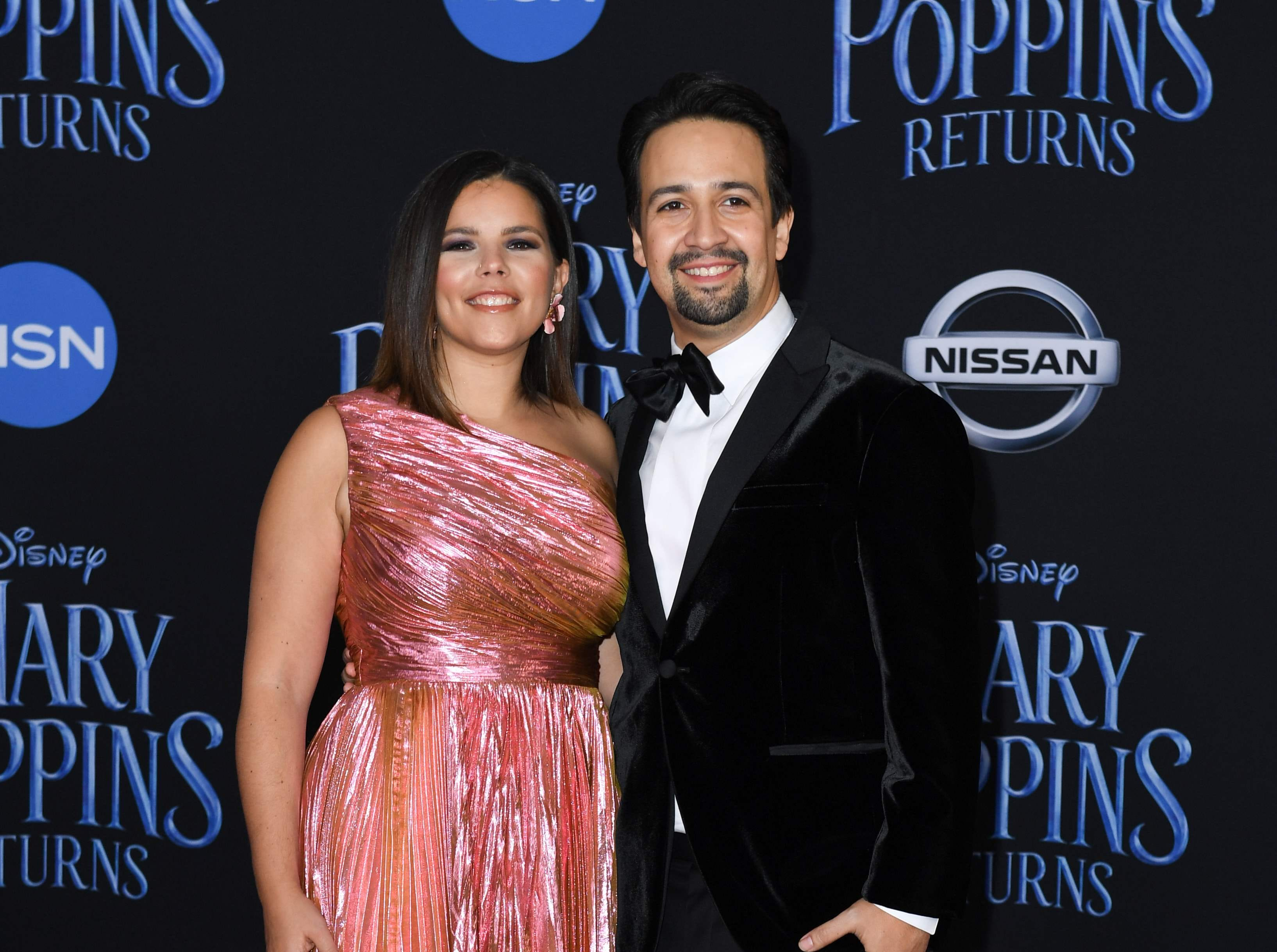 """US composer/playwright/actor Lin-Manuel Miranda and his wife Vanessa Nadal arrive for the world premiere of Disney's """"Mary Poppins Returns"""" at the Dolby theatre in Hollywood on November 29, 2018. (Photo by VALERIE MACON / AFP)VALERIE MACON/AFP/Getty Images ORG XMIT: 'Mary Pop ORIG FILE ID: AFP_1B81DA"""