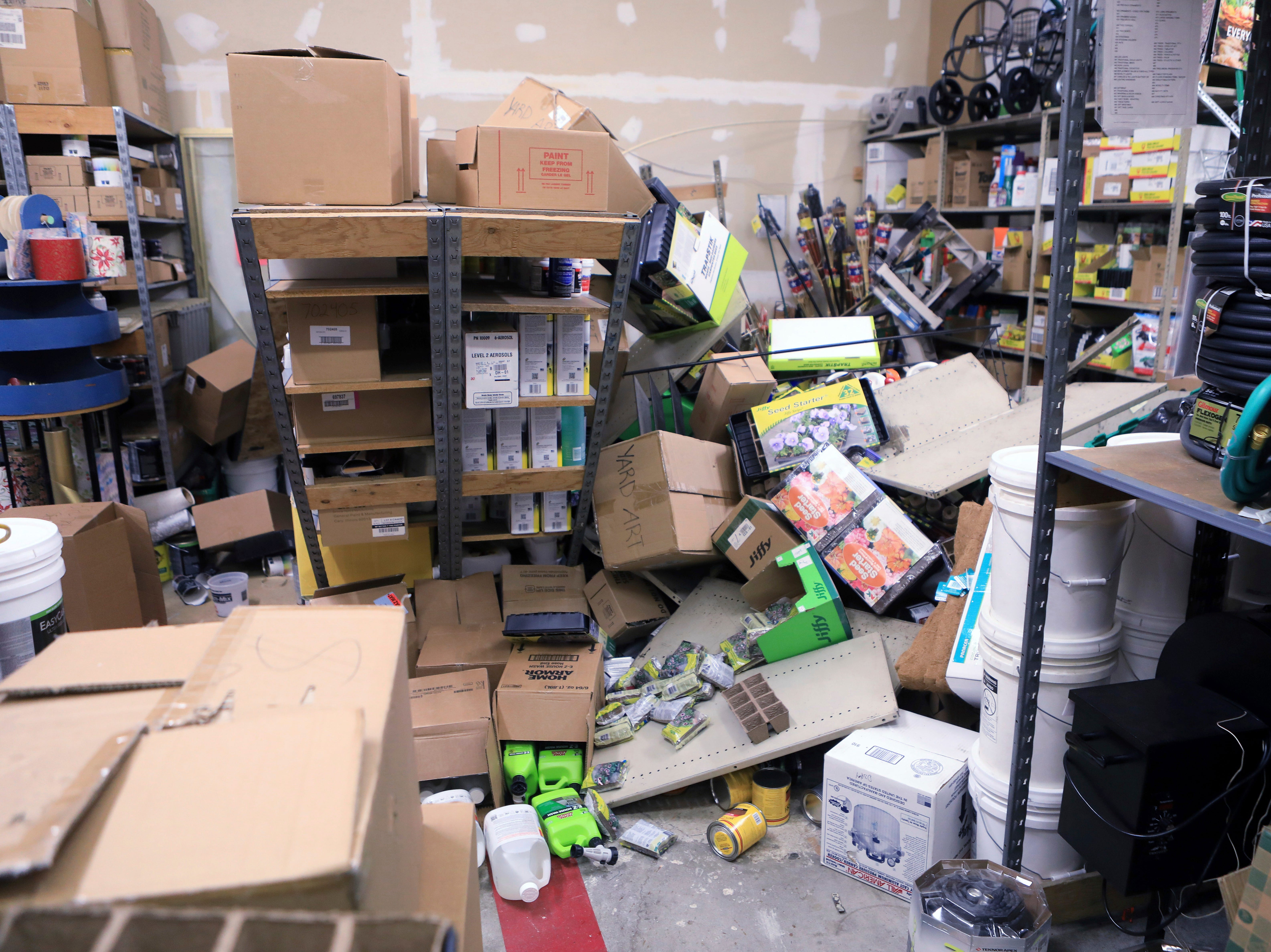 Items from two shelves that came unbolted from a wall are strewn across the floor of the stockroom of Anchorage True Value Hardware following an earthquake Friday morning, Nov. 30, 2018, in Anchorage, Alaska. Store owner Tim Craig says no one was injured in the store but hundreds of items hit the floor from shelves. He says off-duty staffers as well as customers offered to help clean up.