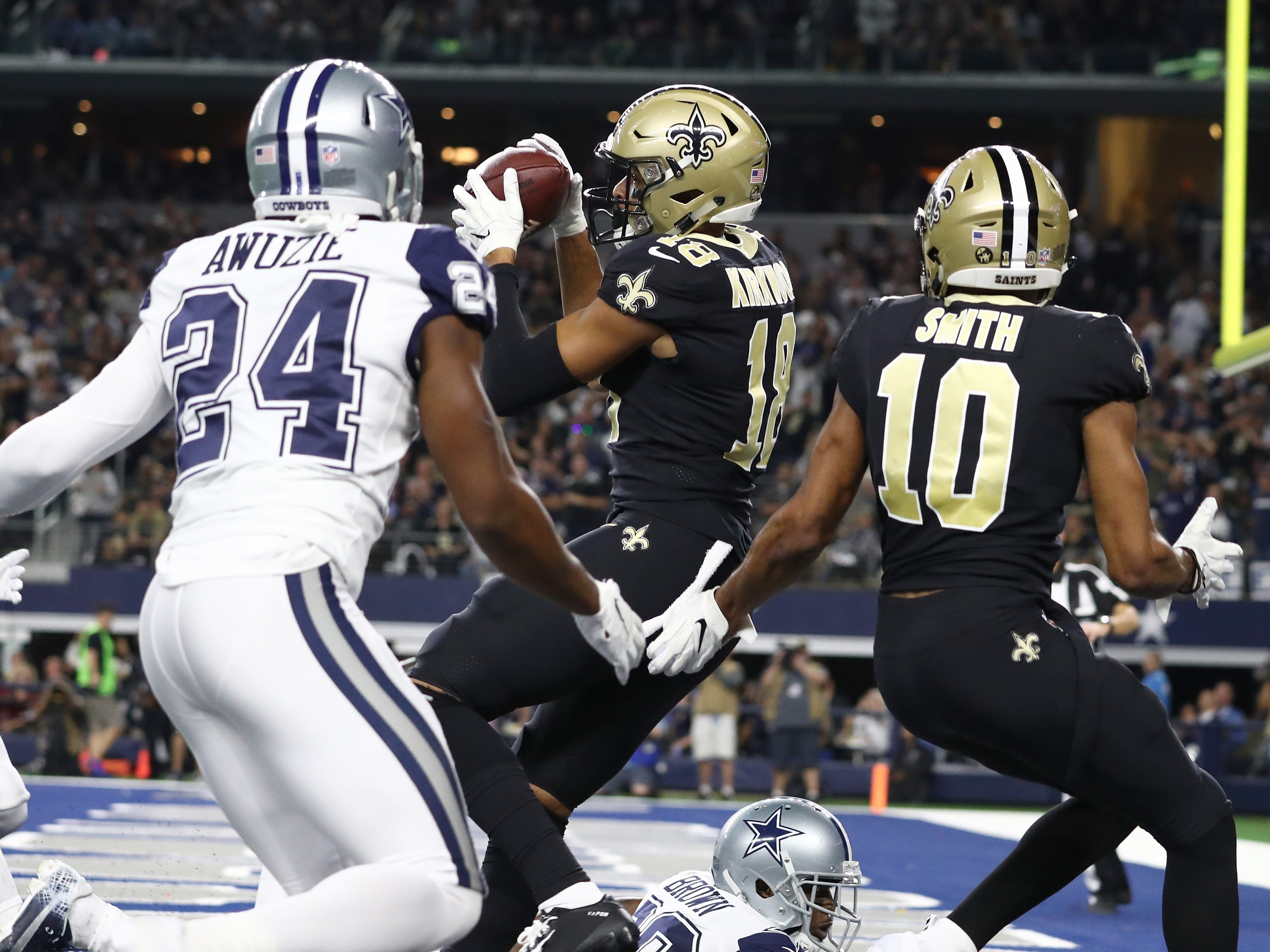 New Orleans Saints receiver Keith Kirkwood catches a touchdown pass against the Dallas Cowboys at AT&T Stadium.