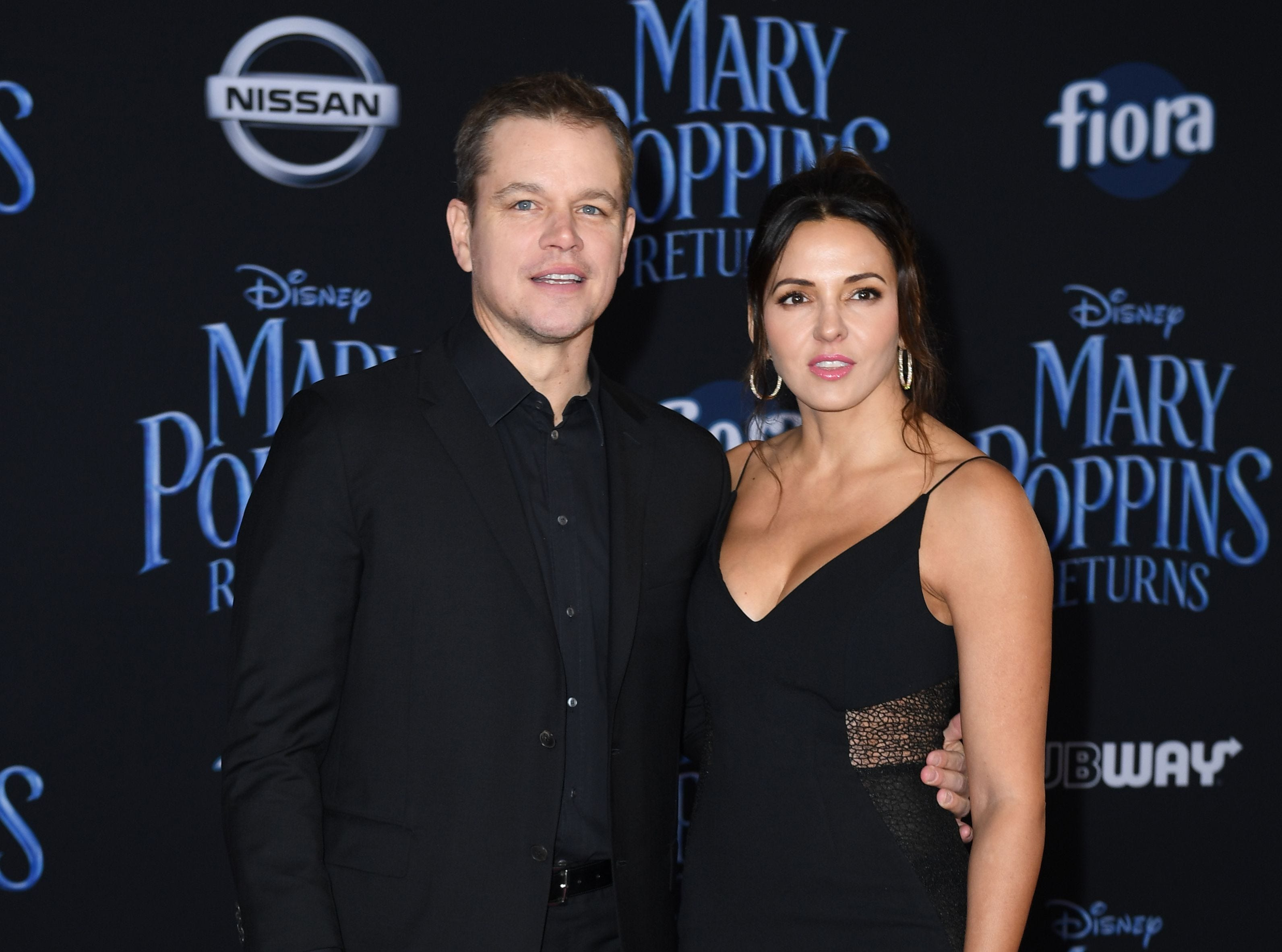 """US actor Matt Damon and his wife Luciana Barroso arrive for the world premiere of Disney's """"Mary Poppins Returns"""" at the Dolby theatre in Hollywood on November 29, 2018. (Photo by VALERIE MACON / AFP)VALERIE MACON/AFP/Getty Images ORG XMIT: 'Mary Pop ORIG FILE ID: AFP_1B8149"""
