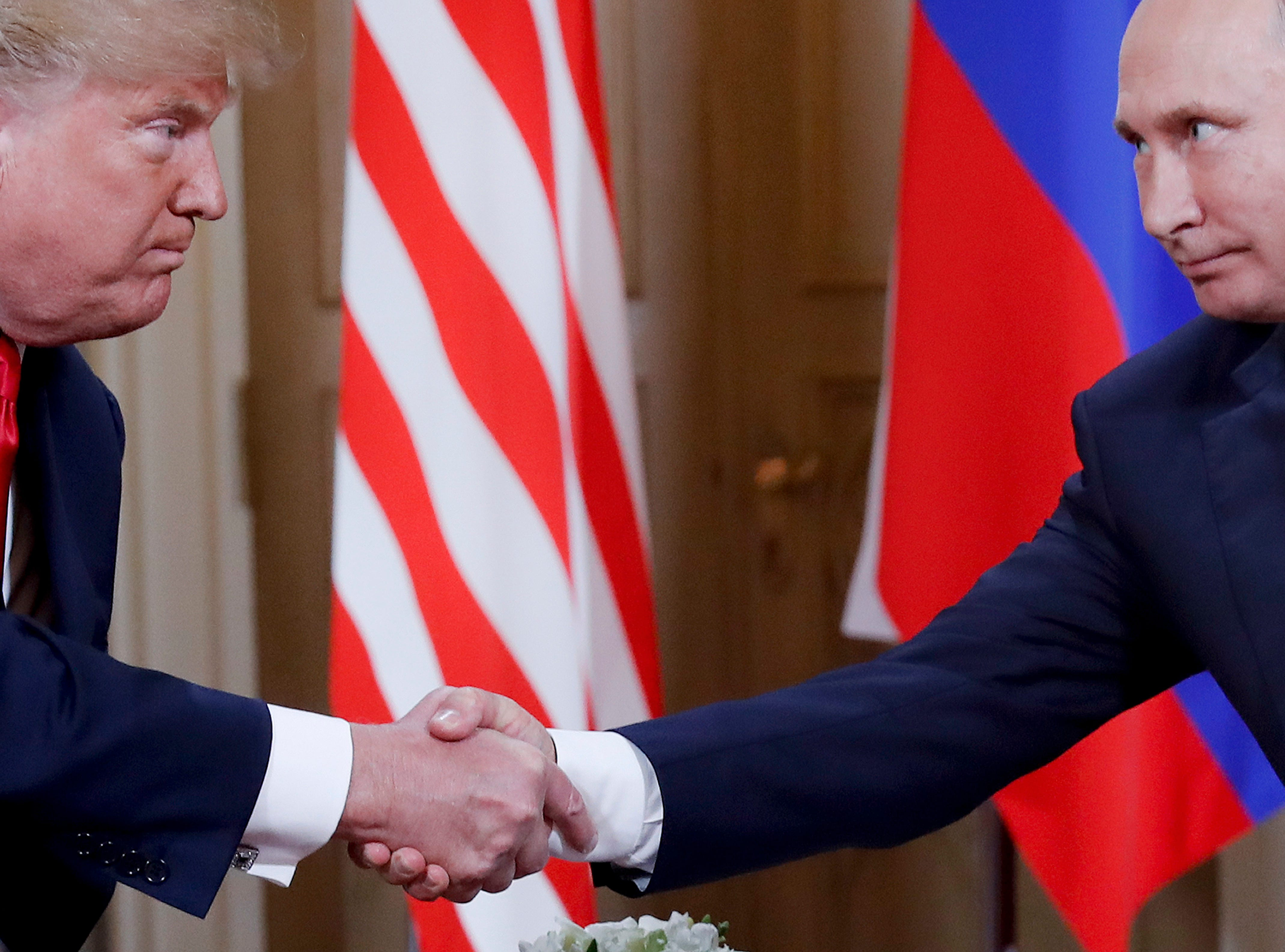 U.S. President Donald Trump and Russian President Vladimir Putin shake hands at the beginning of a meeting at the Presidential Palace in Helsinki, Finland, Monday, July 16, 2018.