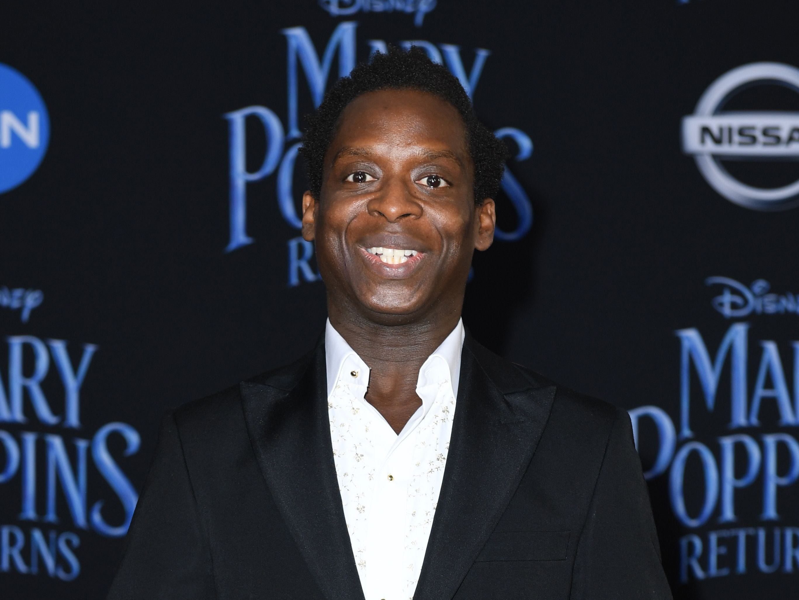 """Ghanaian born British actor Kobna Holdbrook-Smith arrives for the world premiere of Disney's """"Mary Poppins Returns"""" at the Dolby theatre in Hollywood on November 29, 2018. (Photo by VALERIE MACON / AFP)VALERIE MACON/AFP/Getty Images ORG XMIT: 'Mary Pop ORIG FILE ID: AFP_1B80TX"""