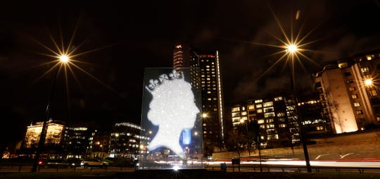 "A sculpture by known as ""One Million Queen"" depicts a profile of Queen Elizabeth II manufactured from crystals and diamonds and illuminated on Park Lane in London, Nov. 29, 2018."