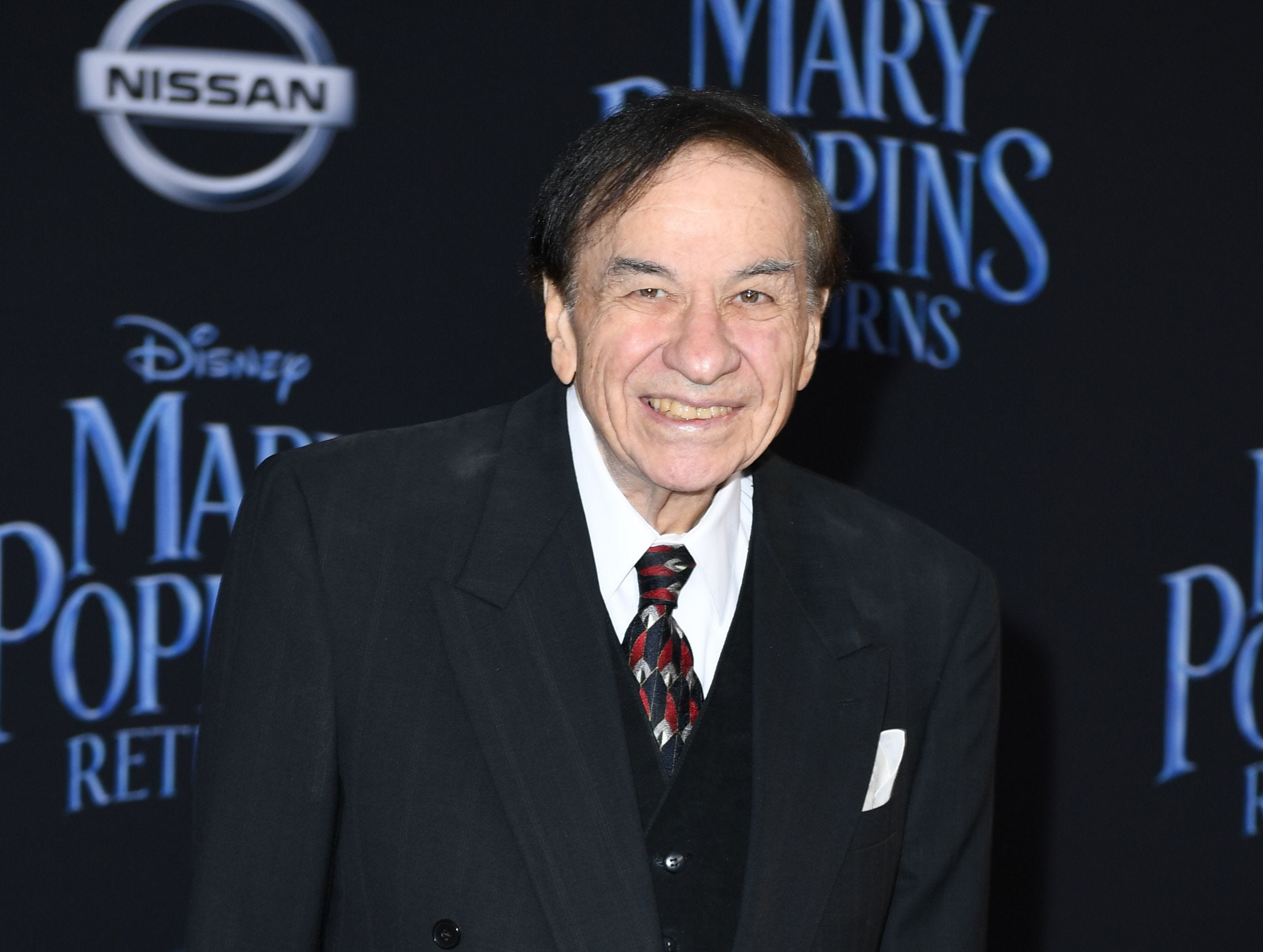 """US songwriter Richard Sherman arrives for the world premiere of Disney's """"Mary Poppins Returns"""" at the Dolby theatre in Hollywood on November 29, 2018. (Photo by VALERIE MACON / AFP)VALERIE MACON/AFP/Getty Images ORG XMIT: 'Mary Pop ORIG FILE ID: AFP_1B816Y"""
