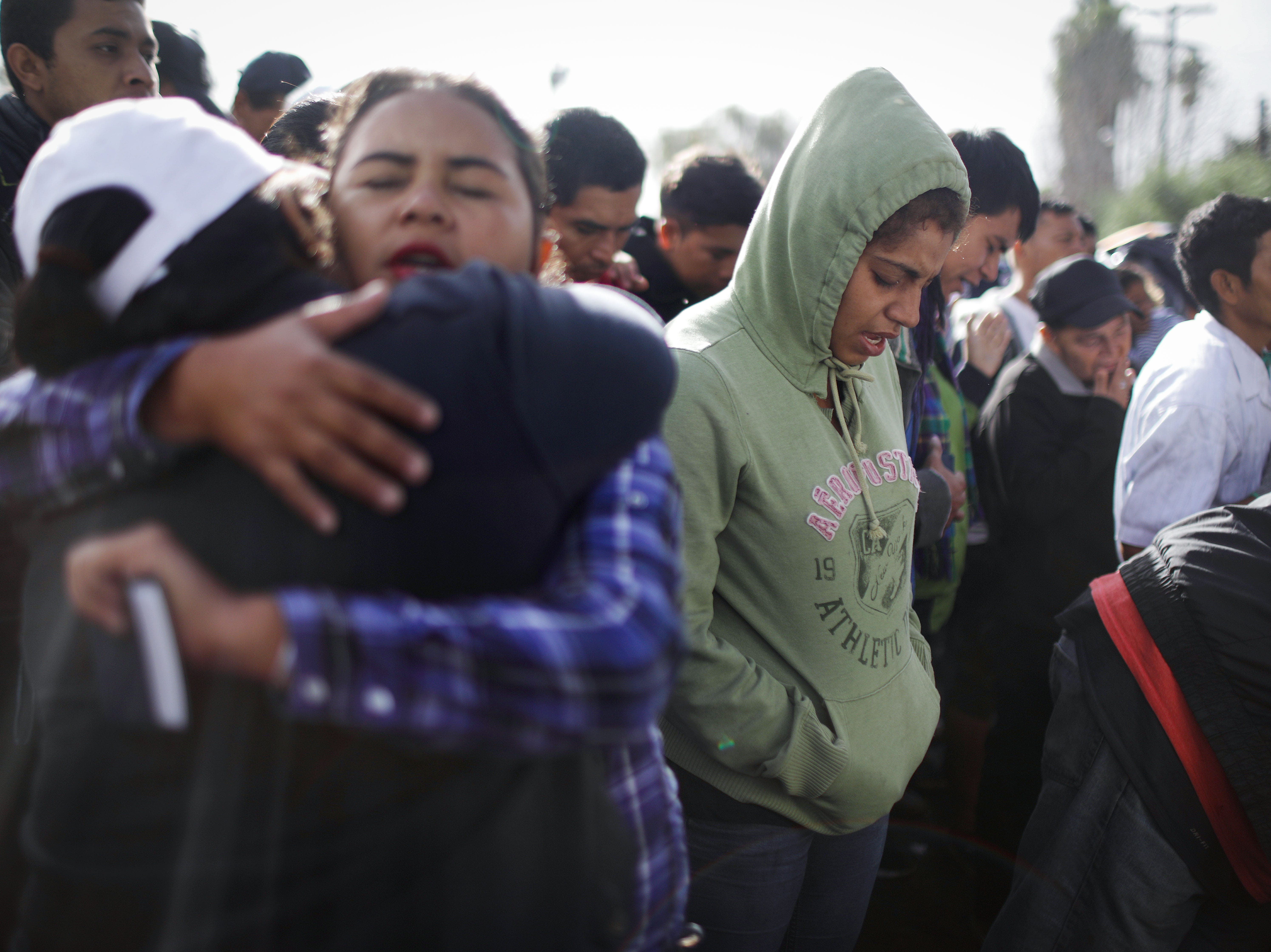 Migrants worship during a street prayer outside the Benito Juarez temporary shelter on Nov. 30, 2018 in Tijuana, Mexico.