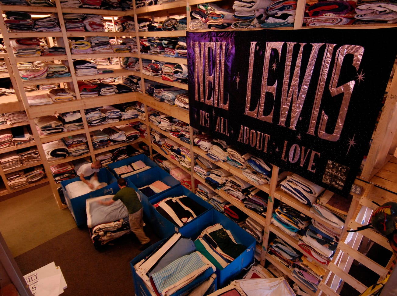 Roddy Williams, foreground, and Chris Mabry are surrounded by shelves full of panels of AIDS quilts at the The NAMES Project Foundation headquarters in Atlanta.