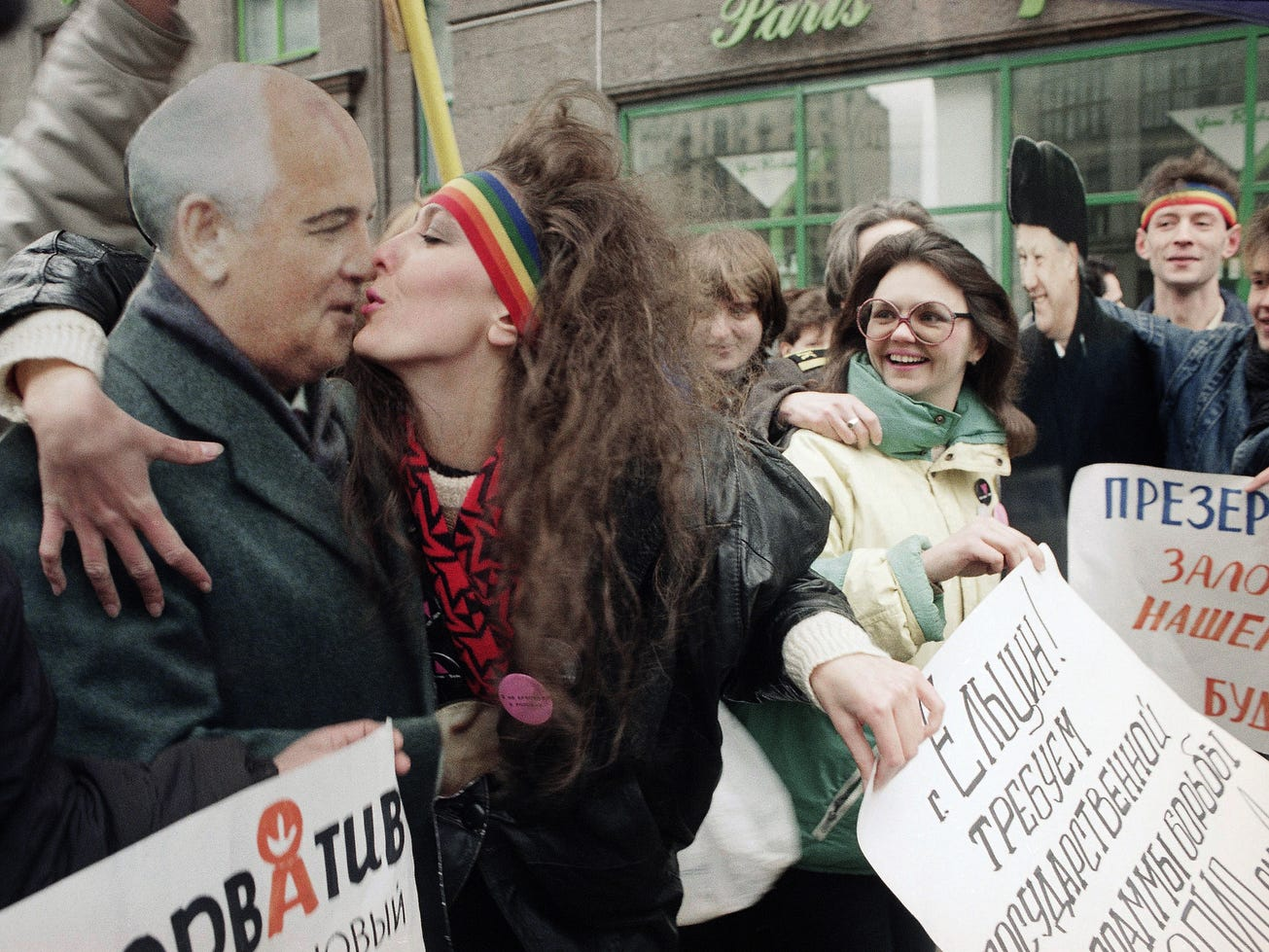 An unidentified woman kisses a life-size cardboard cutout of Soviet President Mikhail Gorbachev during a demonstration marking World Aids Day in Moscow on  Dec. 1, 1991.