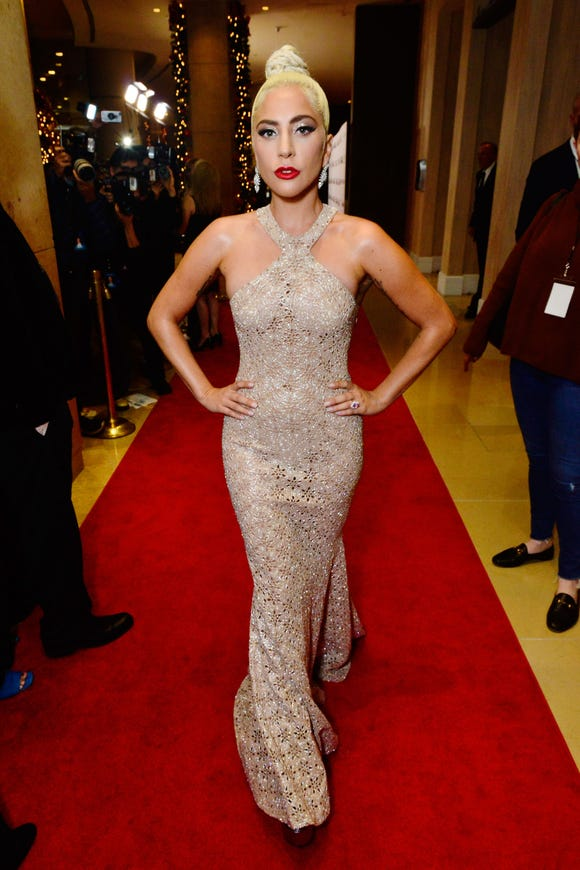 Lady Gaga sported a laser-cut Azzedine Alaïa halter gown.