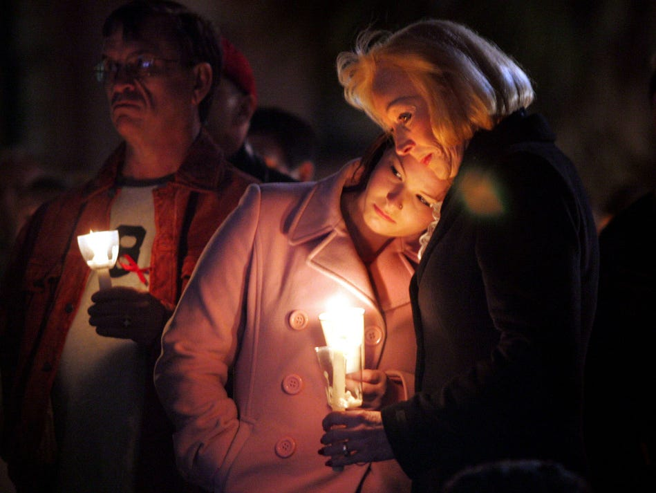 Caitlin Ullery, left, and her mother, Pamela, participate in the World AIDS Day 2005 candlelight vigil at the U.S. Customs House, in Charleston, S.C. They were there to honor Pamela's brother Skip who died of AIDS in 1993.