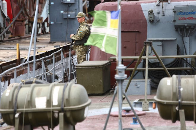 A Ukrainian frontier soldier on a patrol boat on the Sea of Azov on Aug. 14, 2018.