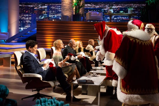 "Rent-a-Santas pitch their business to ABC's ""Shark Tank"" crew of (from left) Mark Cuban, Barbara Corcoran, Kevin O'Leary, Lori Greiner and Daymond John."