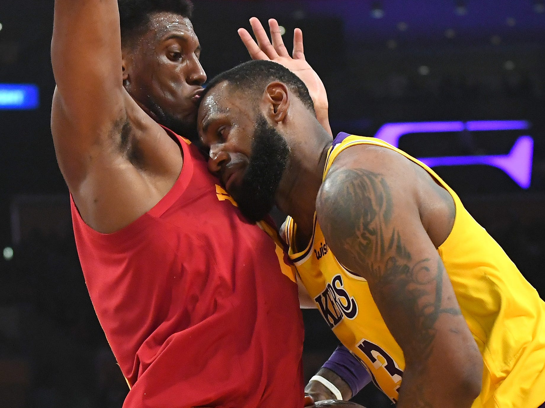 Nov. 29: Lakers forward LeBron James collides face-first with Pacers forward Thaddeus Young's chest during the second half in Los Angeles.