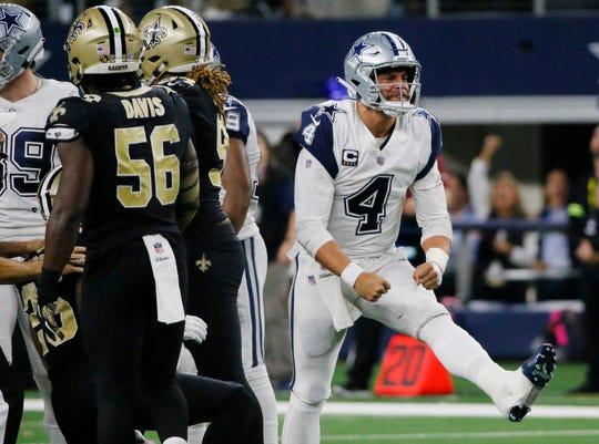 Dallas Cowboys quarterback Dak Prescott (4) celebrates after a run play against the New Orleans Saints during the second half of an NFL football game, in Arlington, Texas, Thursday, Nov. 29, 2018. Dallas won 13-10. (AP Photo/Roger Steinman) ORG XMIT: TXEG154