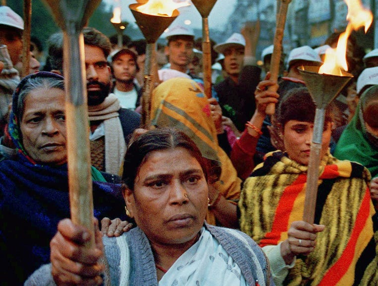 Protesters, many of them prostitutes and health care workers march in New Delhi's red light district, calling for job opportunities and medical facilities on Dec. 1, 1997, which marks World AIDS Day. The UN estimates that India has between 3 and 5 million HIV-positive citizens, making it the country with the most cases in the world.