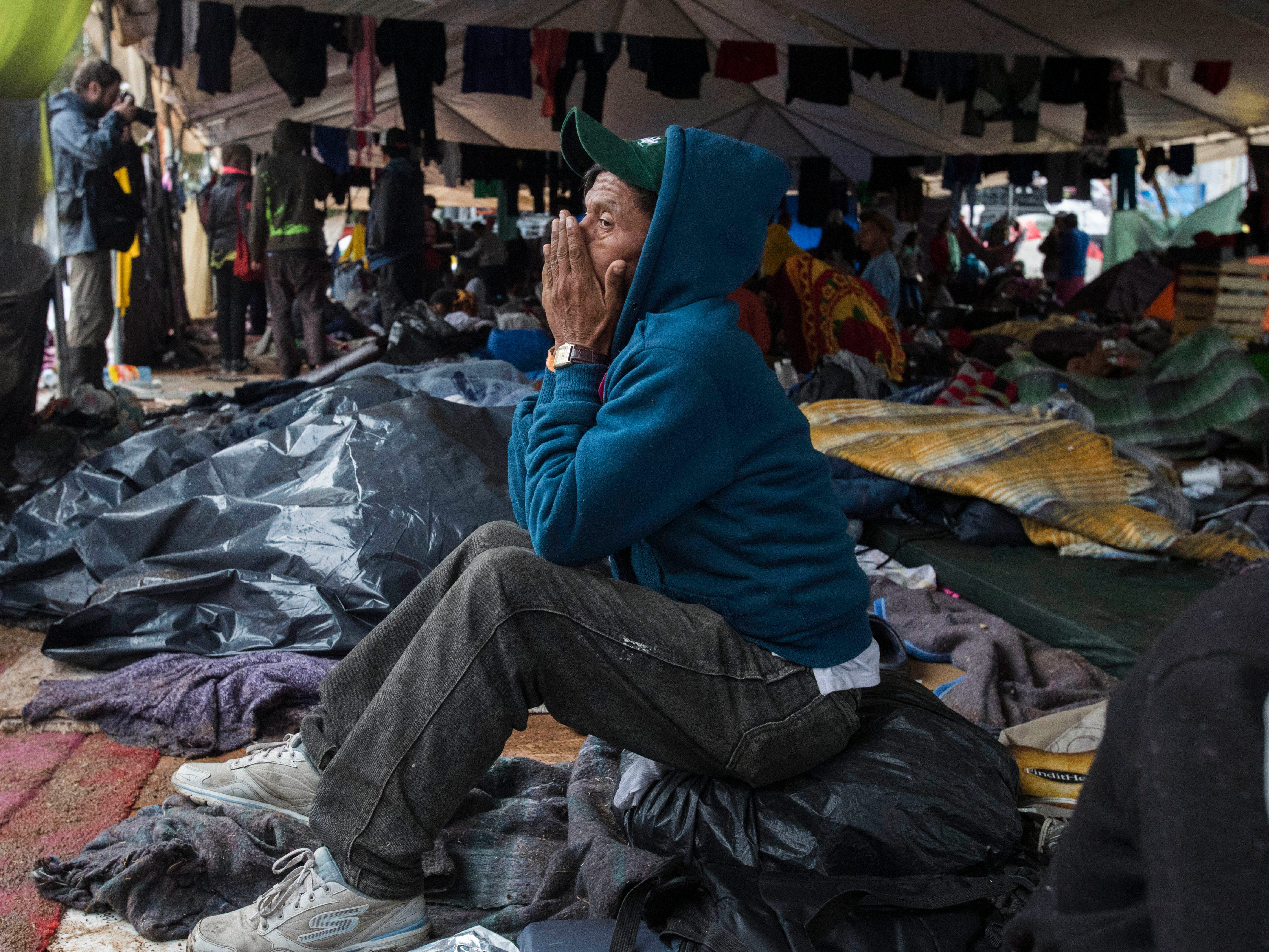 A migrant man from El Salvador contemplates his situation at the Benito Juarez sports complex in Tijuana, Mexico on Nov. 29, 2018.
