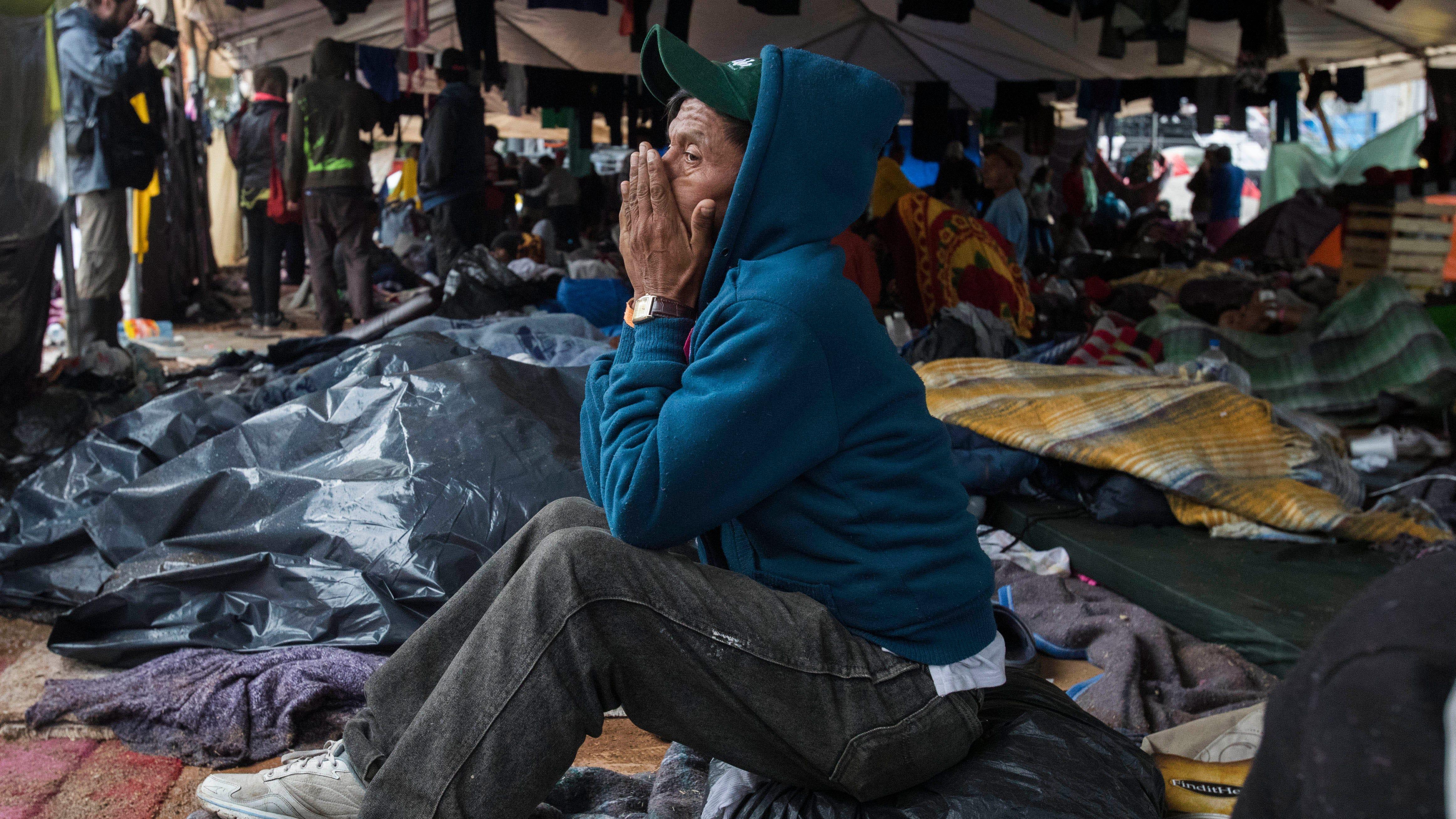 A migrant man from El Salvador contemplates his situation at the Benito Juarez sports complex in Tijuana, Mexico on Nov. 29, 2018.