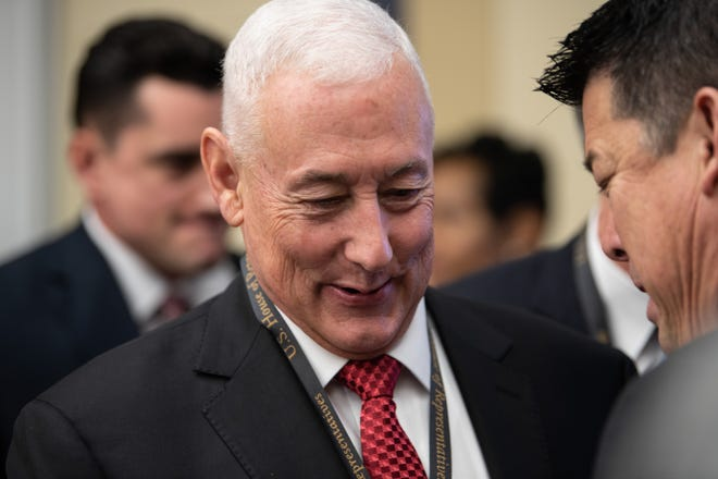 U.S. Rep.-elect Greg Pence, R-Ind., speaks with California Democrat T.J. Cox while waiting for the start of the office lottery that determines the order in which new members of Congress select their offices. -- Photo by Hannah Gaber, USA TODAY Staff