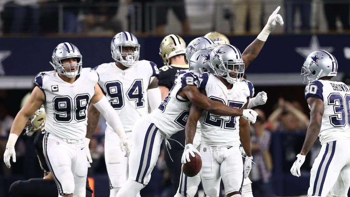Cowboys cornerback Jourdan Lewis celebrates his fourth quarter interception.