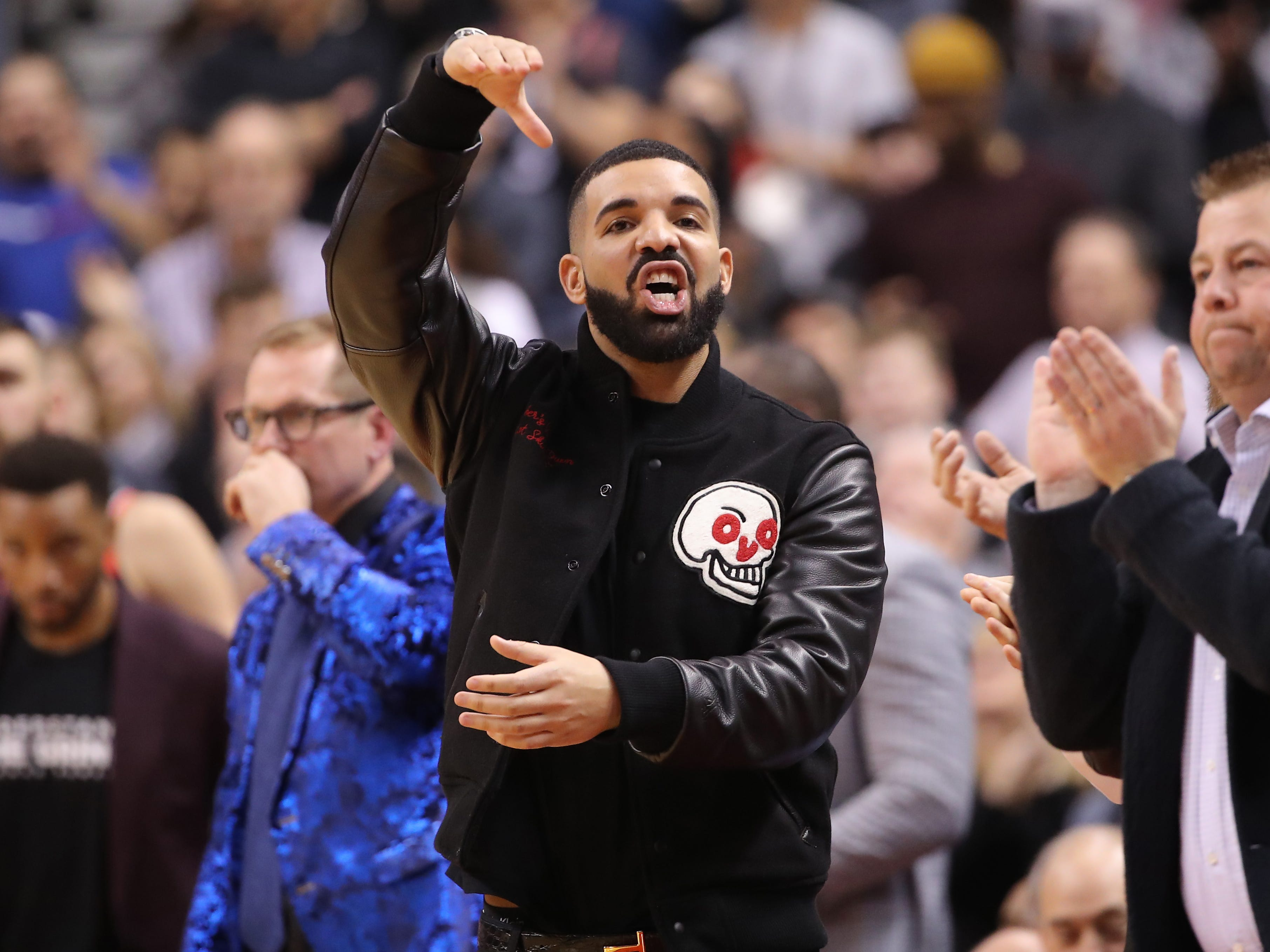 Nov. 29: Raptors superfan and team ambassador Drake takes in a game against the Warriors at Scotiabank Arena in Toronto.