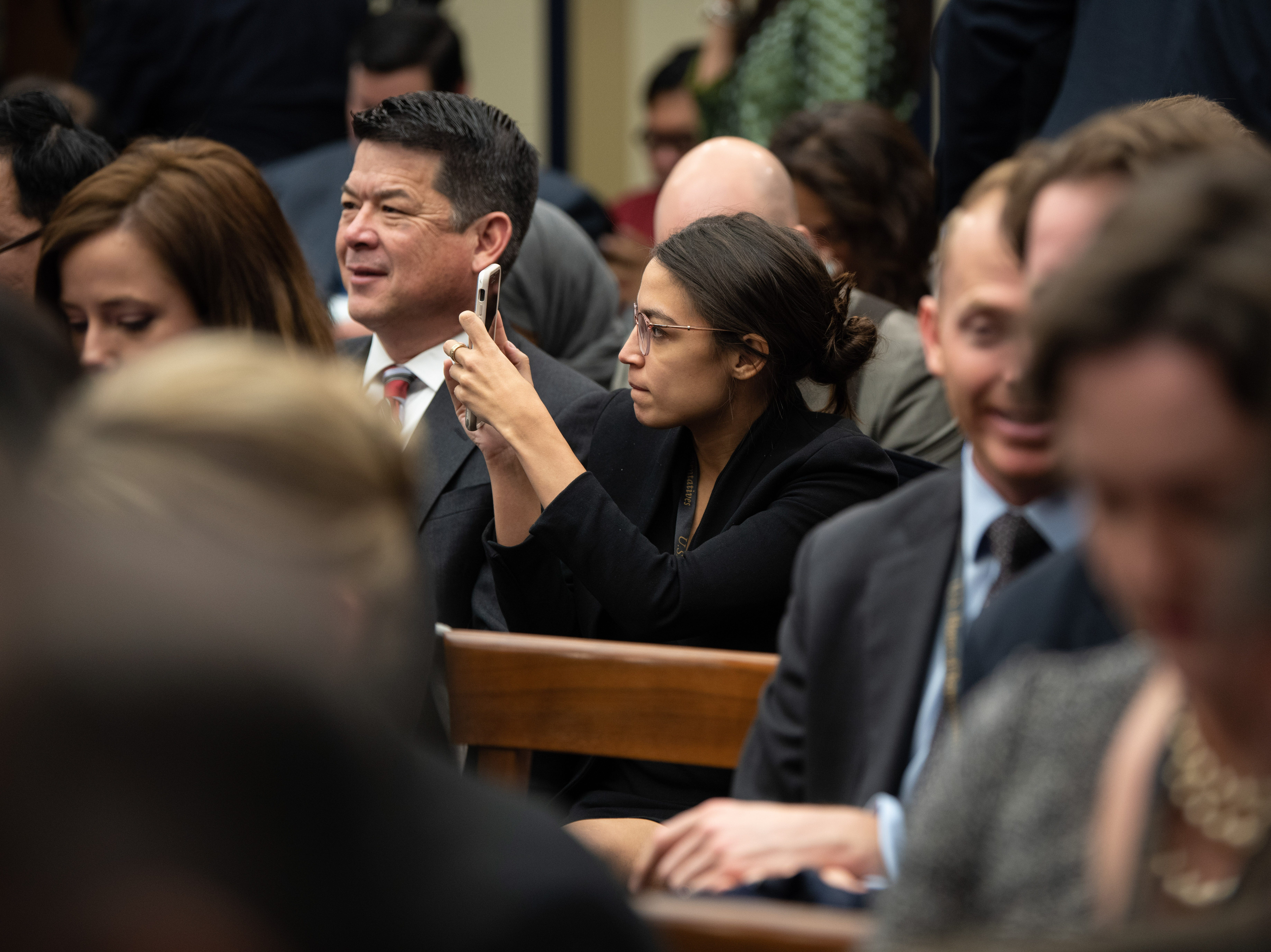 {Nov. 30, 2018} {10:30 a.m.} -- Washington, DC  -- Rep. Elect Alexandria Ocasio-Cortez (D, N.Y.) takes photos ahead of the lottery that determines the order in which new members of Congress will select their offices. -- Photo by Hannah Gaber, USA TODAY Staff