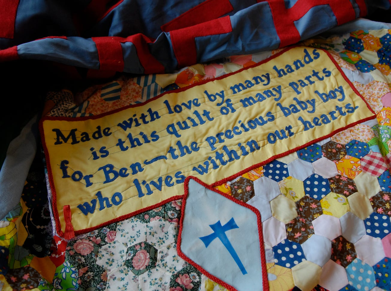 A detail from a panel created by 4 generations of the family of Benjamin Thomas West-Campbell, of Washington state, who died in 1992, when he was 4 months-old is seen in 2006 at The NAMES Project Foundation headquarters.