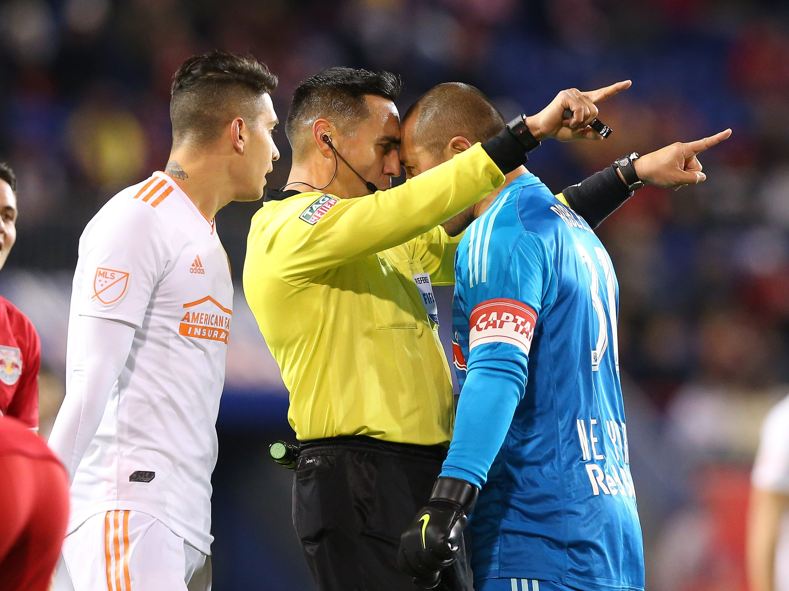 New York Red Bulls goalkeeper Luis Robles argues with referee Jair Antonio Marrufo during the first half of the second leg of the MLS Eastern Conference Championship at Red Bull Arena.
