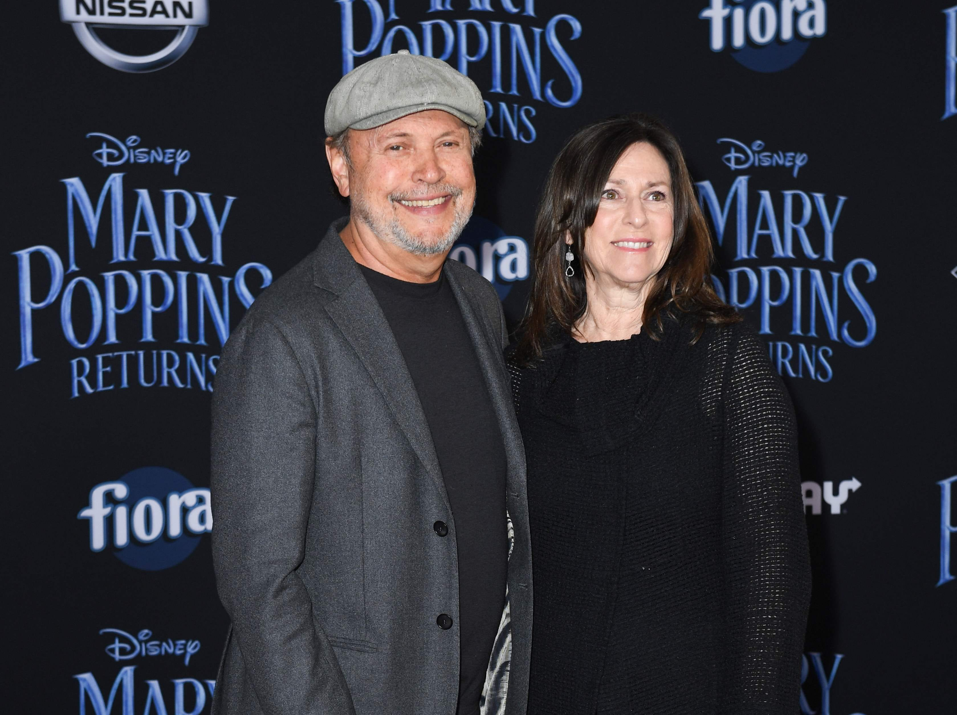 """US actor Billy Crystal and his wife Janice Crystal arrive for the world premiere of Disney's """"Mary Poppins Returns"""" at the Dolby theatre in Hollywood on November 29, 2018. (Photo by VALERIE MACON / AFP)VALERIE MACON/AFP/Getty Images ORG XMIT: 'Mary Pop ORIG FILE ID: AFP_1B81M0"""