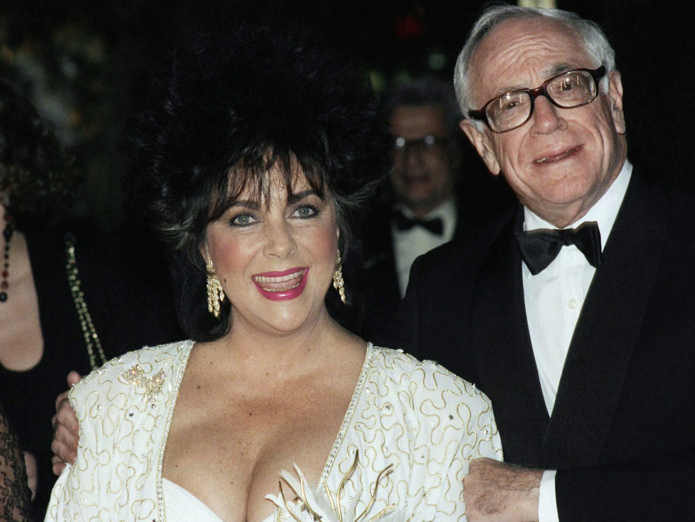 Celebrities joined the movement putting a focus on the dreaded disease.  Actress Elizabeth Taylor and her friend, publisher Malcolm Forbes speak to the press before a dinner at the World Financial Center in New York at night on  Dec. 2, 1989. Taylor was later honored for her contribution in combating AIDS, in observance of World AIDS Day.