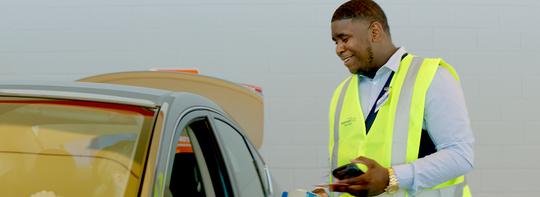 Online Grocery Pickup Associate Jordan Walker loads a delivery order in Pinellas Park, Florida.