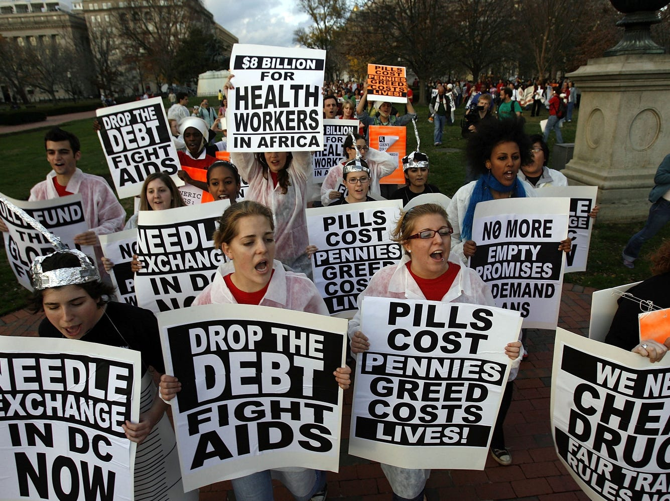 Demonstrators demand needle exchange programs and lower prices for medicines that fight HIV/AIDS in front of the White House on World AIDS Day 2006, in Washington, DC.