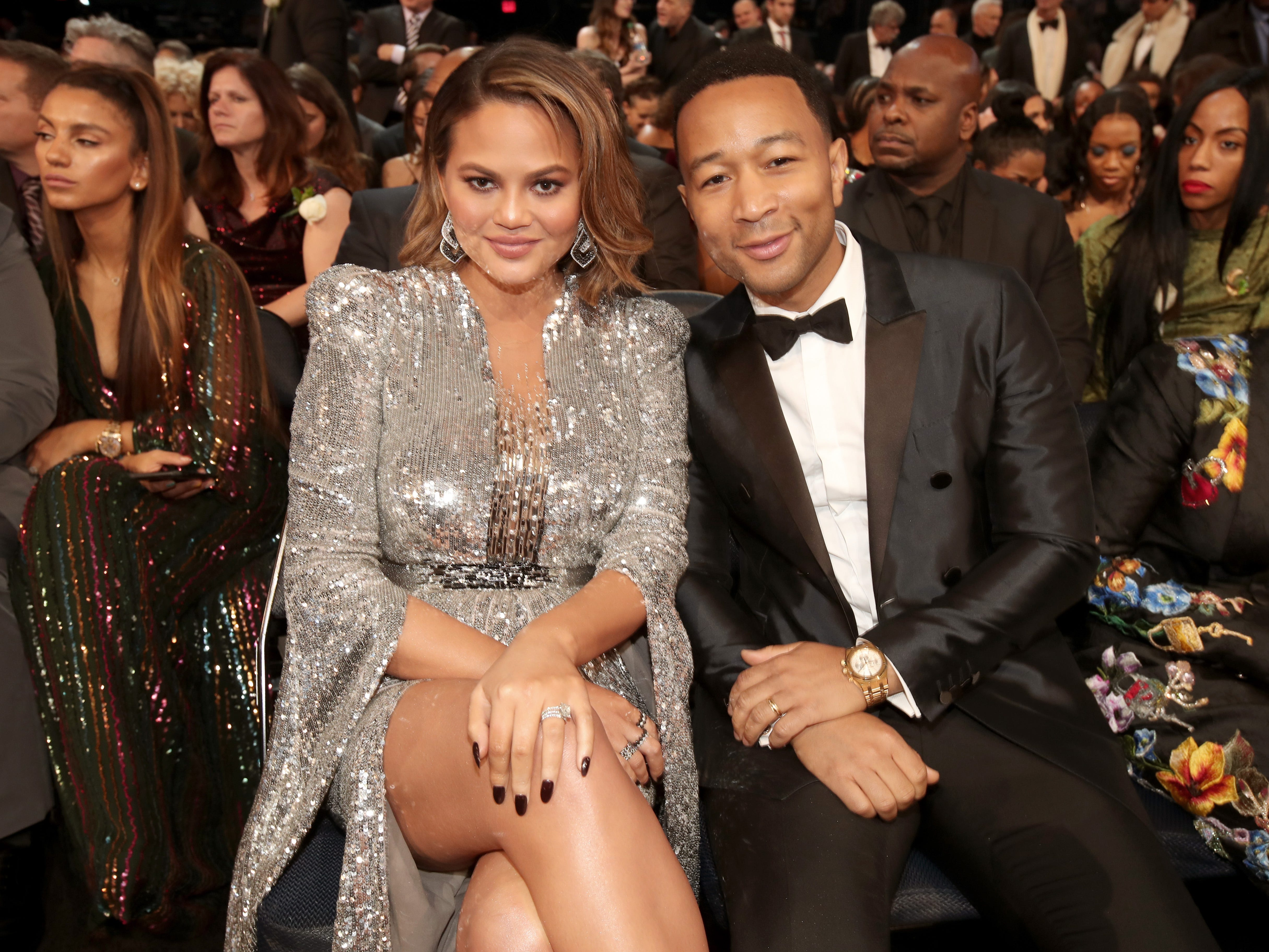 January 28: The internet's favorite couple, Chrissy Teigen and John Legend, smile from the front row at the Grammy Awards.