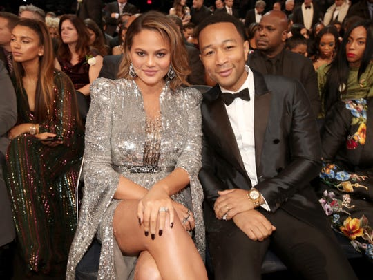 The internet's favorite couple, Chrissy Teigen and John Legend, smile from the front row at the Grammy Awards.