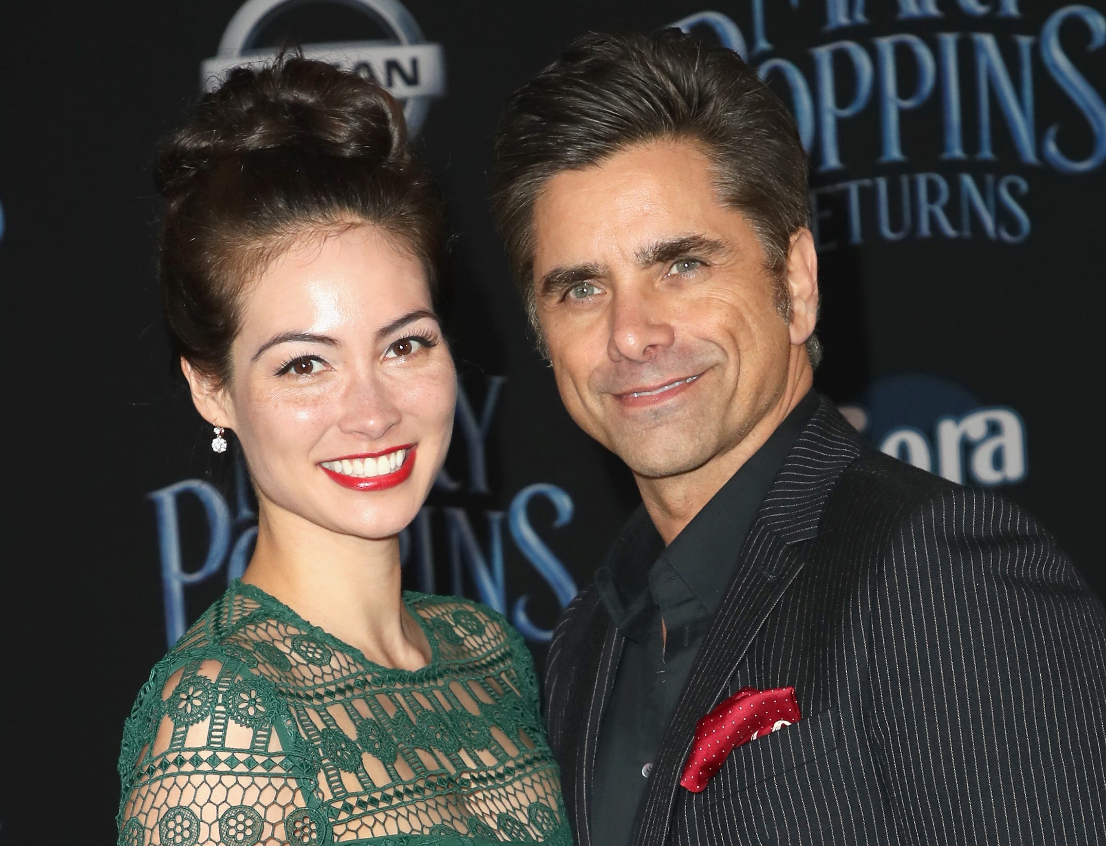"""LOS ANGELES, CALIFORNIA - NOVEMBER 29: Caitlin Mchugh and John Stamos attend the Premiere Of Disney's """"Mary Poppins Returns"""" at El Capitan Theatre on November 29, 2018 in Los Angeles, California. (Photo by David Livingston/Getty Images) ORG XMIT: 775258987 ORIG FILE ID: 1074753300"""