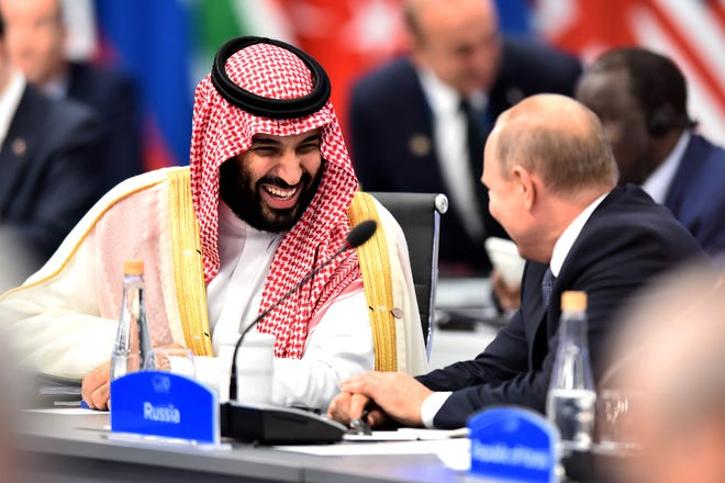 Crown Prince of Saudi Arabia Mohammad bin Salman al-Saud shares a laugh with Russian President Vladimir Putin during the opening day of Argentina G20 Leaders' Summit 2018 at Costa Salguero on November 30, 2018 in Buenos Aires, Argentina.