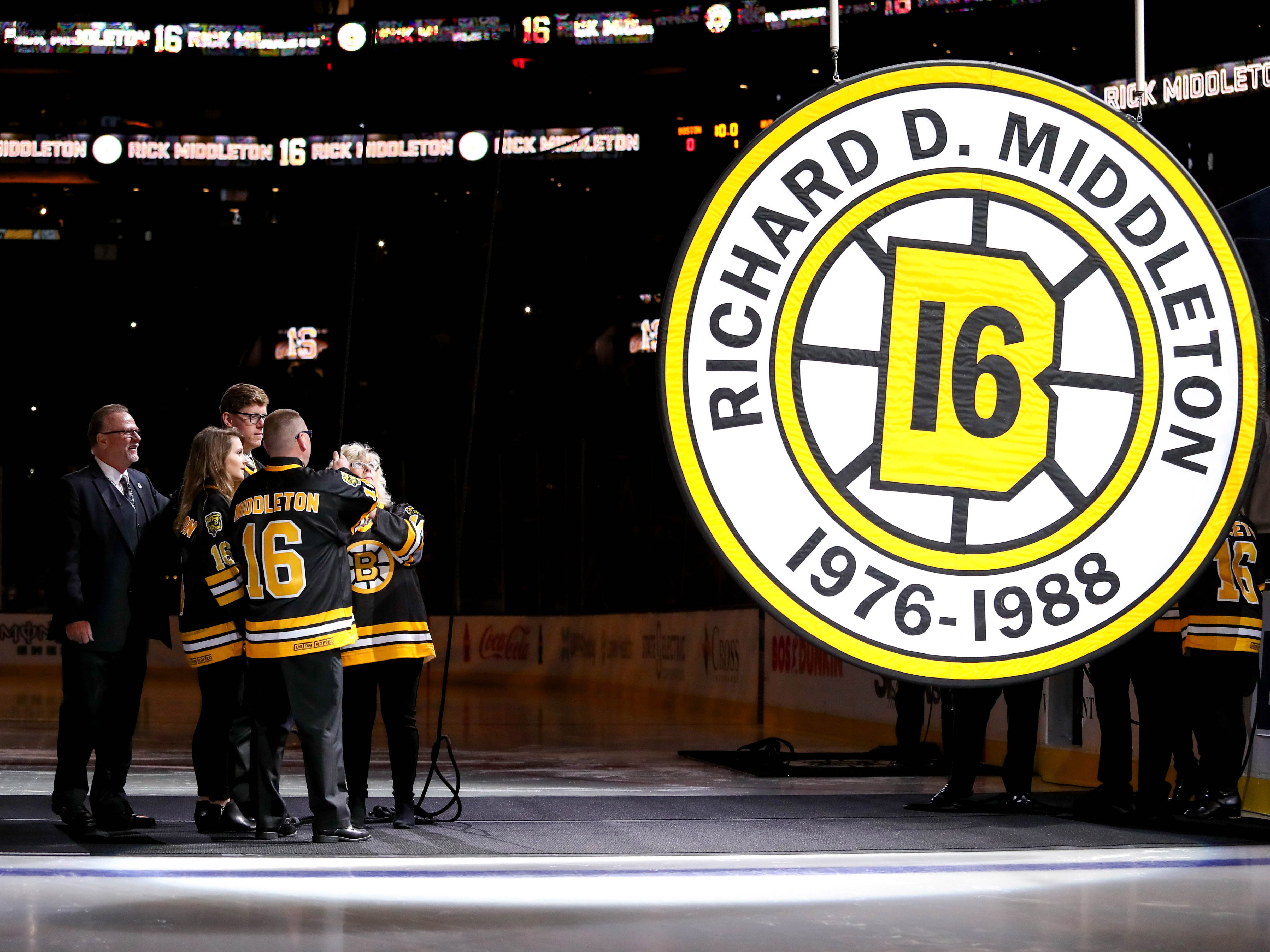 Nov. 29: Former Boston Bruins star Rick Middleton (far left) watches as his retired number is raised to the rafters at TD Garden.
