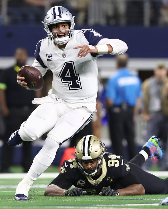 Dallas Cowboys quarterback Dak Prescott runs with the ball in the second quarter against the New Orleans Saints.