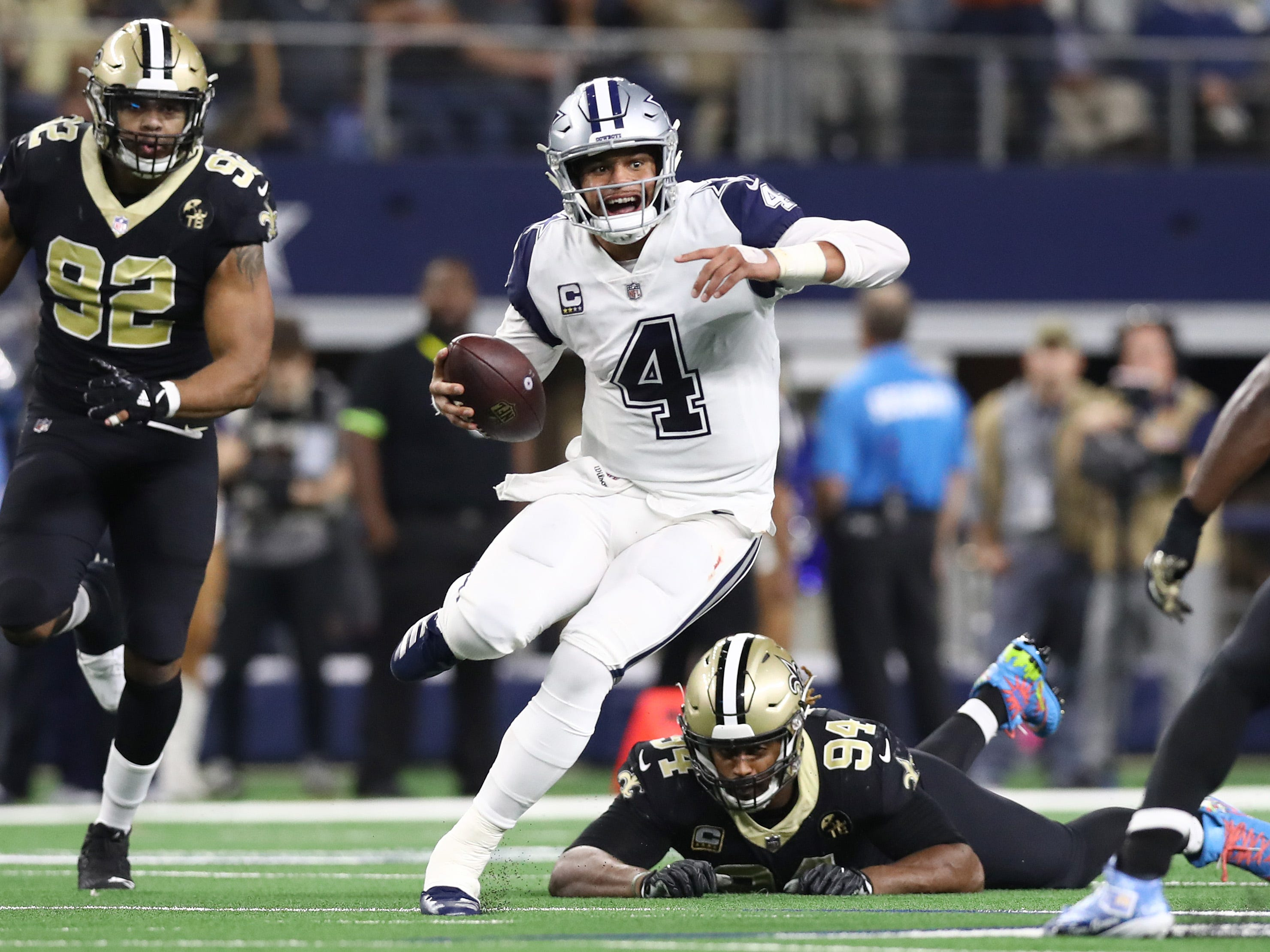 Dallas Cowboys quarterback Dak Prescott runs with the ball in the second quarter against the New Orleans Saints.