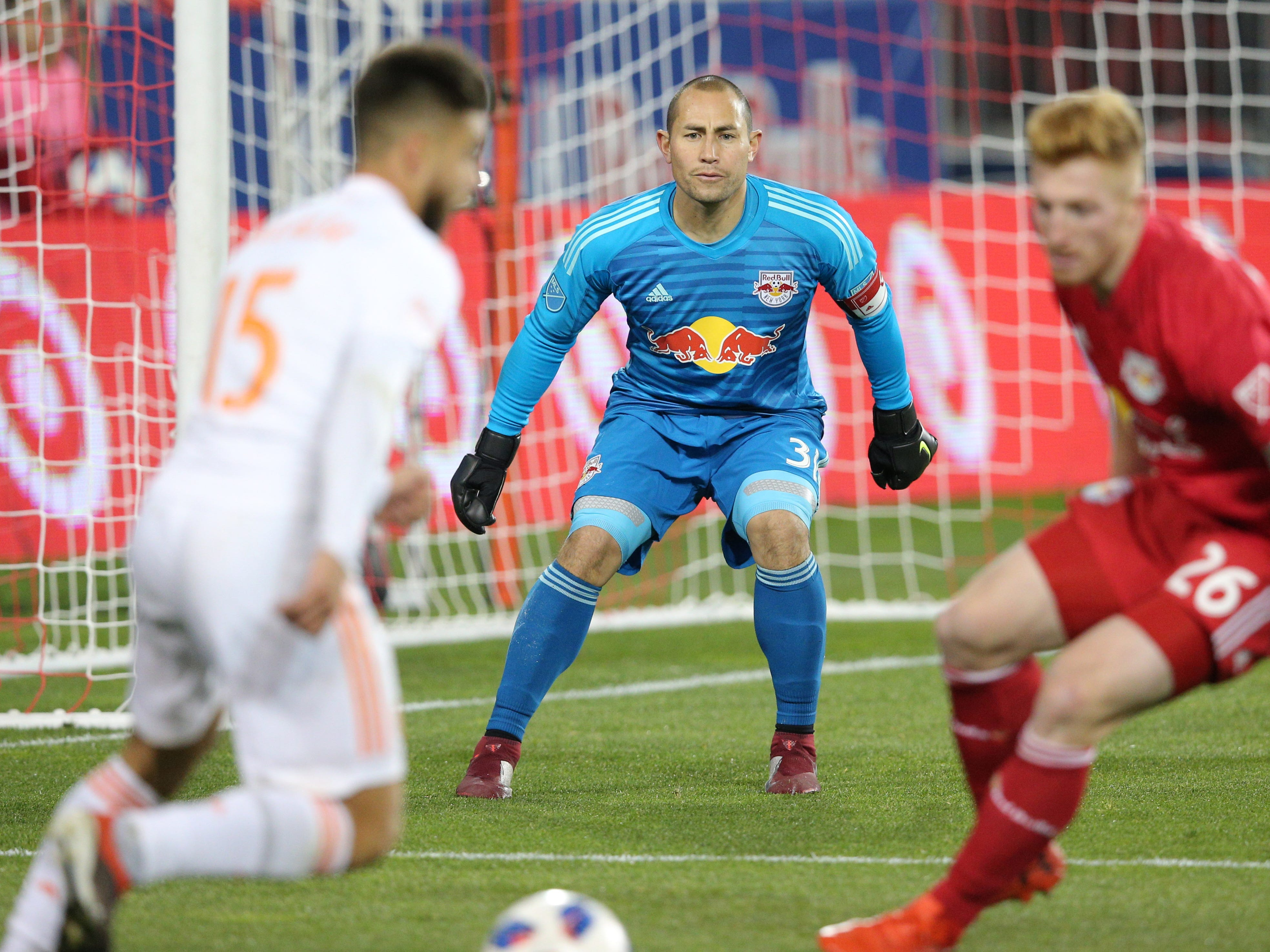 New York Red Bulls goalkeeper Luis Robles defends the goal against Atlanta United forward Hector Villalba (15) during the second half of the second leg of the MLS Eastern Conference Championship at Red Bull Arena.
