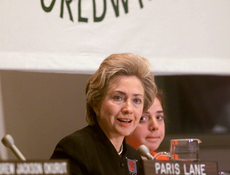 First Lady Hillary Rodham Clinton addresses the United Nations World AIDS Day symposium, on Dec. 1, 1999.  Looking on is moderator Alexandra Berke, a reporter for Children's Express.