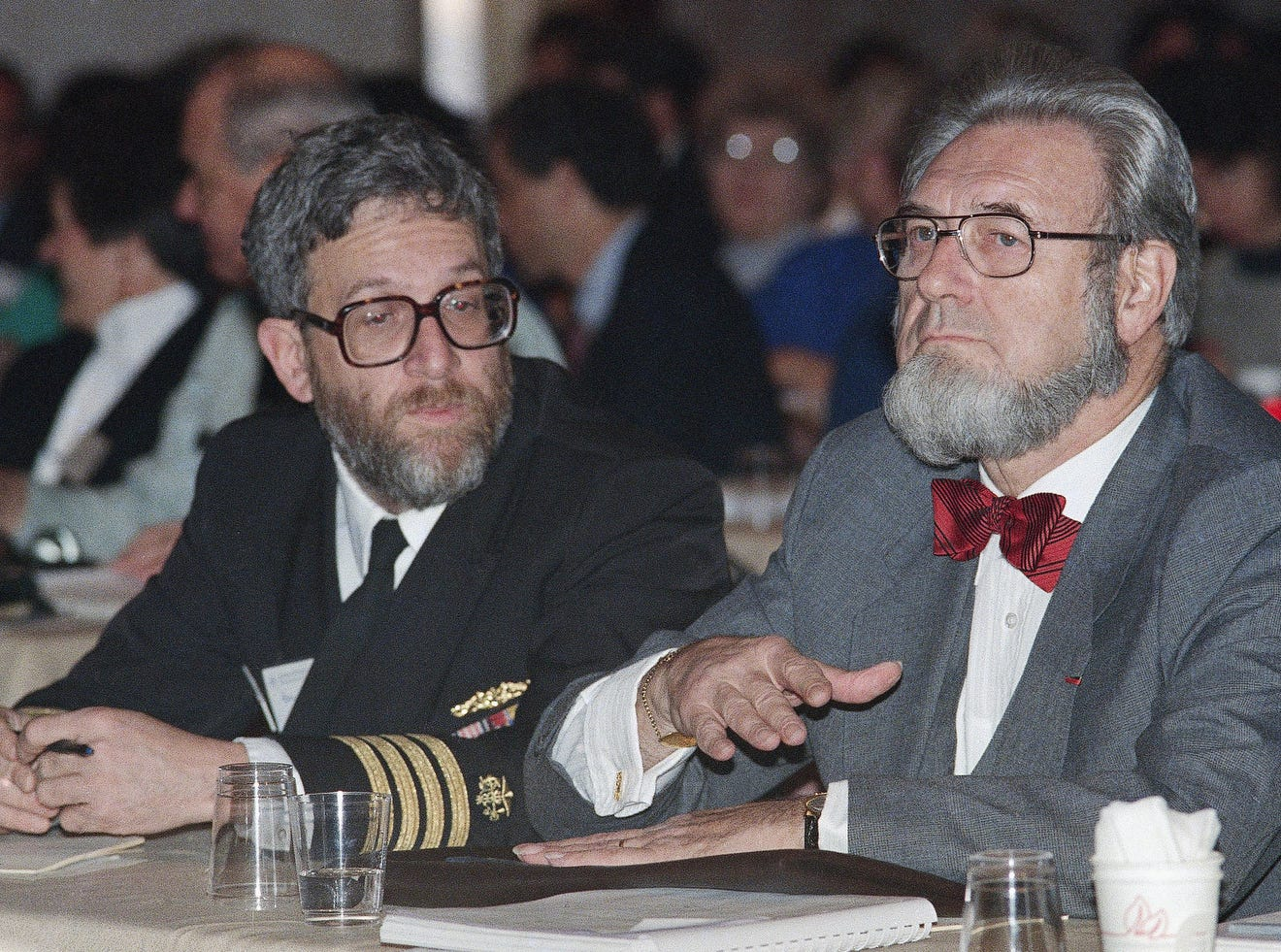 U.S. Surgeon General C. Everett Koop, right,  gestures, on Dec. 1, 1988, in Boston as he addresses a meeting of the American Society of Law & Medicine and other area health organizations on the fight against AIDS into the next decade, as part of World AIDS Day, designated by the World Health Organization.