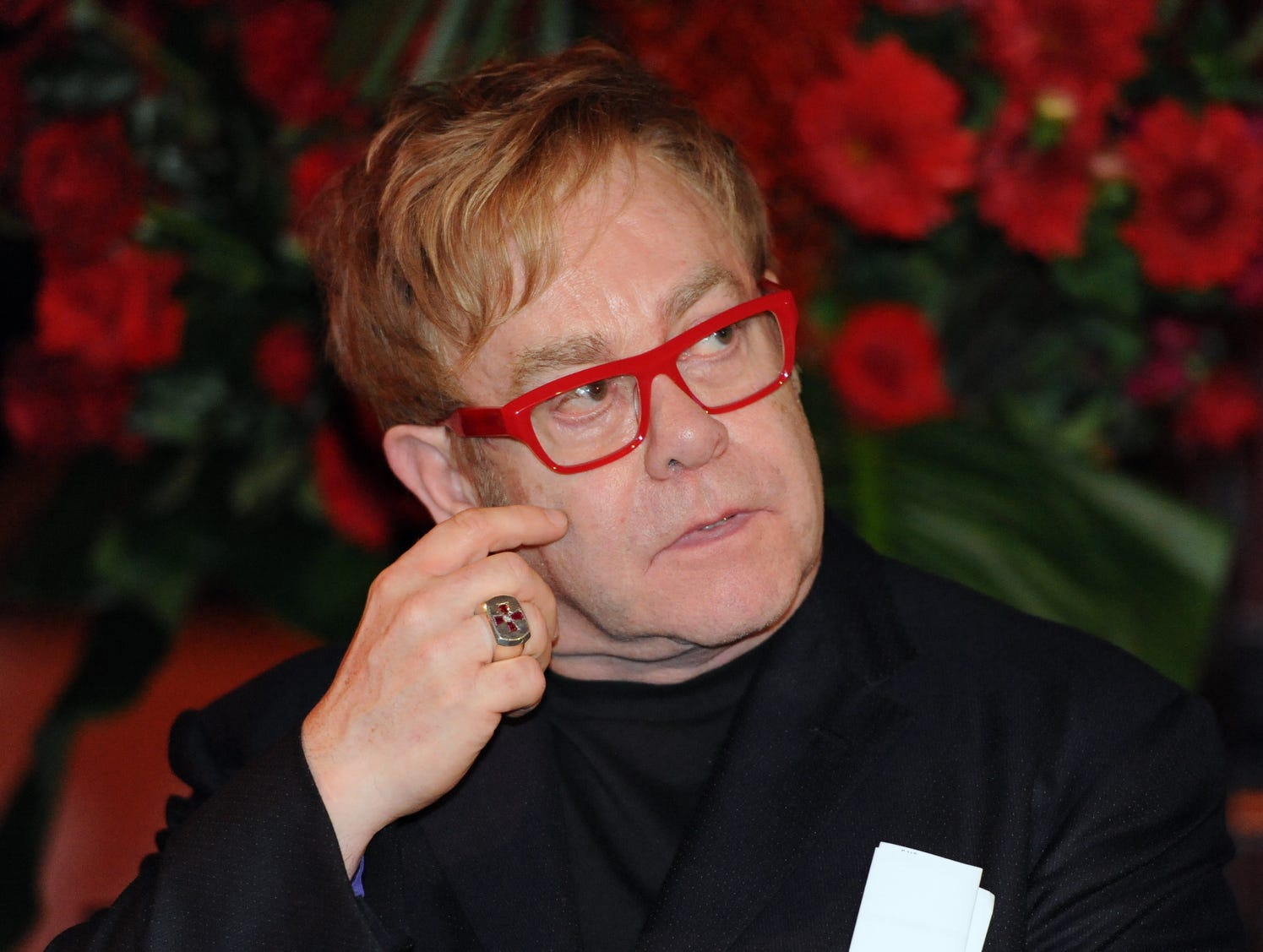 British singer songwriter Sir Elton John attends the World AIDS Day event in Sydney on Dec.1, 2011. He has a foundation and continues to hold benefits to raise money for the cure.