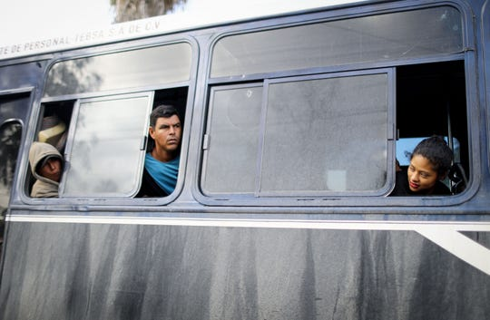 Migrants depart on a bus from a temporary shelter where they were staying, on their way to a new shelter on the eastern side of the city, on Nov. 30, 2018 in Tijuana, Mexico. Rains yesterday in Tijuana brought flooding to sections of the old shelter, which is located in a soccer complex. Officials hope to re-locate at least 3,000 of the migrants, many from the 'migrant caravan', to the new shelter. Around 6,000 migrants from Central America were crowded into the original shelter which was intended to hold 3,000.