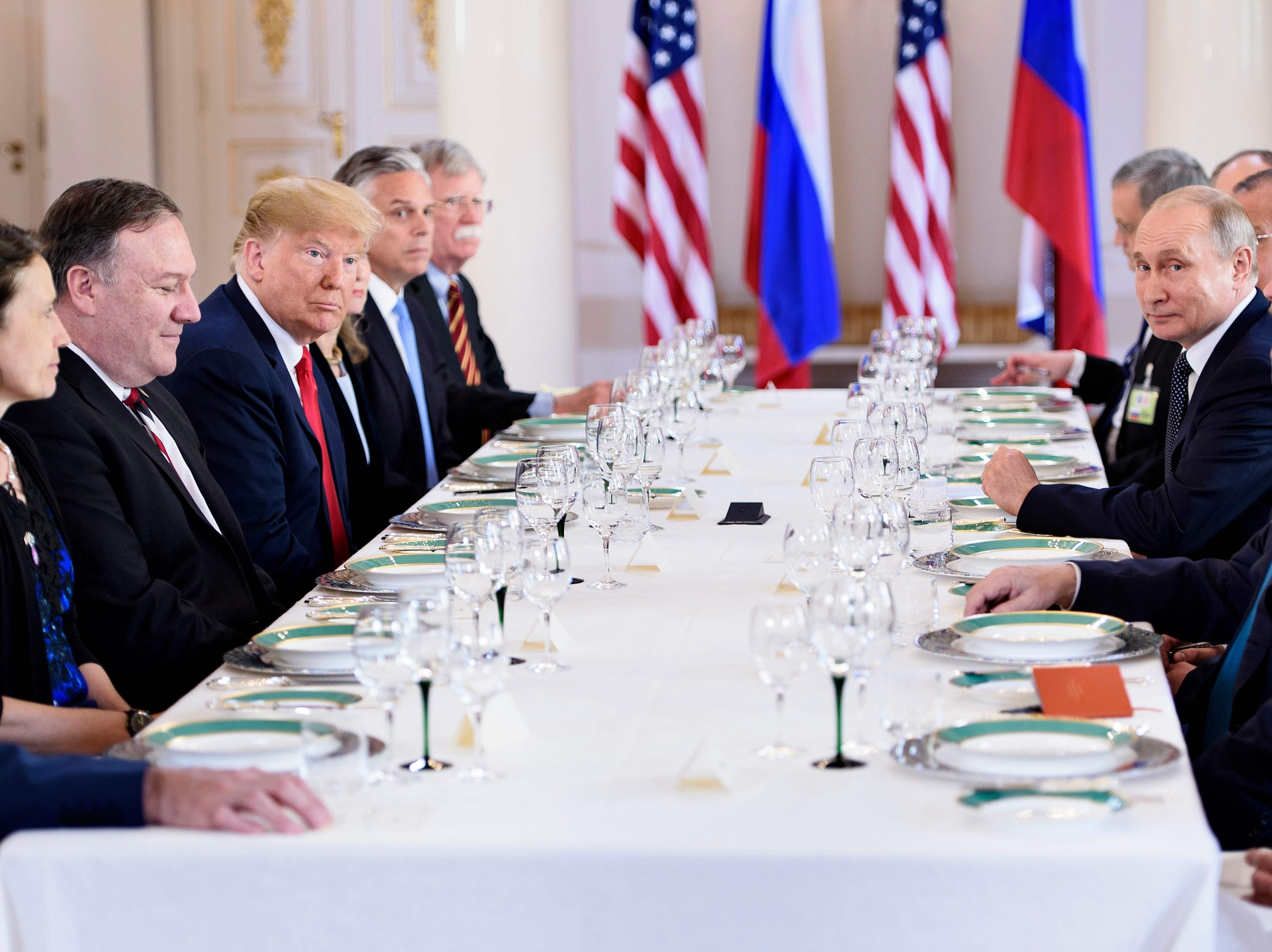 "US President Donald Trump, Russia's President Vladimir Putin and others wait for a working lunch meeting at Finland's Presidential Palace on July 16, 2018 in Helsinki, Finland. The US and Russian leaders opened an historic summit in Helsinki, with Donald Trump promising an ""extraordinary relationship"" and Vladimir Putin saying it was high time to thrash out disputes around the world."
