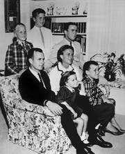 In this 1964 file photo, George H.W. Bush sits on a couch with his wife, Barbara, and their children, Dorothy and Marvin. George W. Bush sits at right behind his mother. Behind the couch are Neil and Jeb Bush.